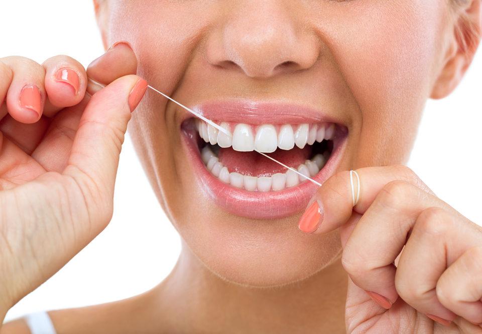 flossing her teeth